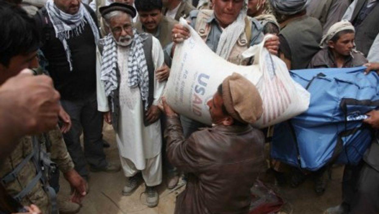 Afghanistan landslide victims receive aid.