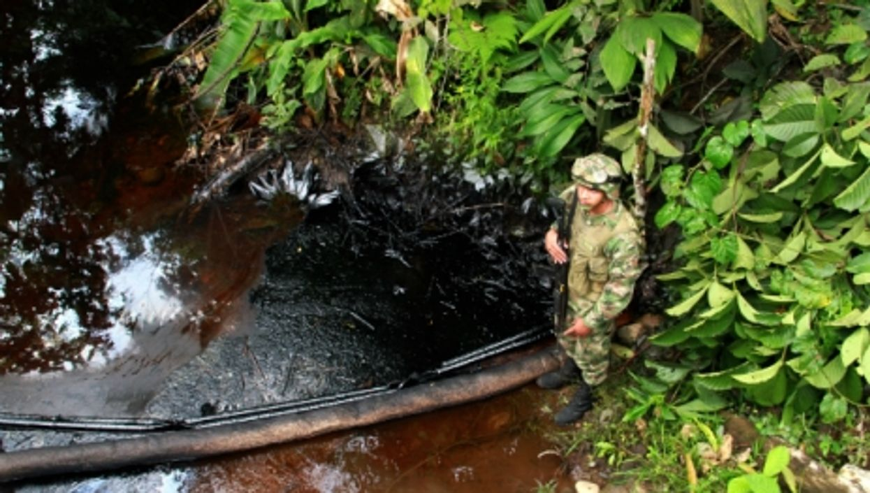 After the FARC intercepted a convoy of trucks transporting crude oil in Colombia's state of Putumayo, in July 2014.