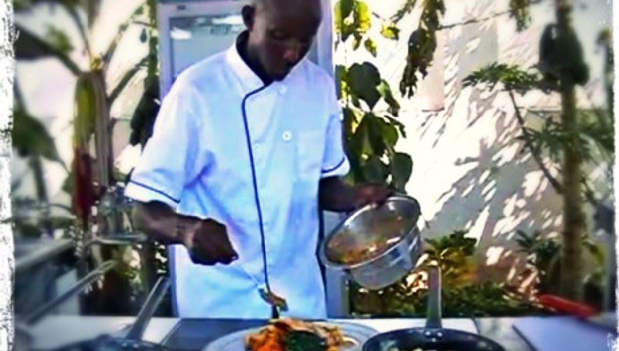 Ahmed Jama working at Mogadishu's The Village restaurant