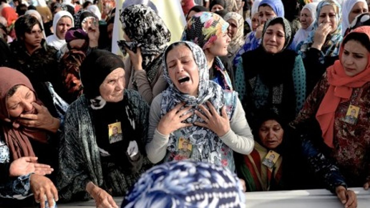 Al-Hasakah, Syria - Women mourn during a funeral of Kurdish fighters killed by ISIS.