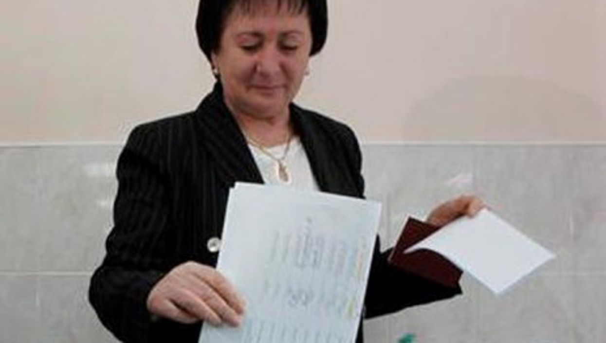 Alla Dzhioyeva casting her ballot during the first round of elections.