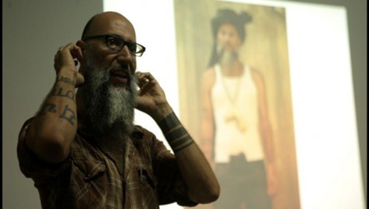 """Amanullah Mojadidi in front of his """"Jihadi Gangster"""" character"""
