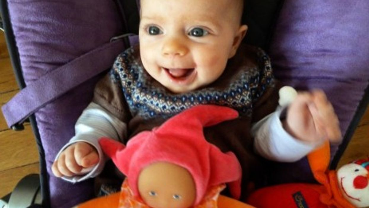 An 11-week-old baby enjoying a funny moment