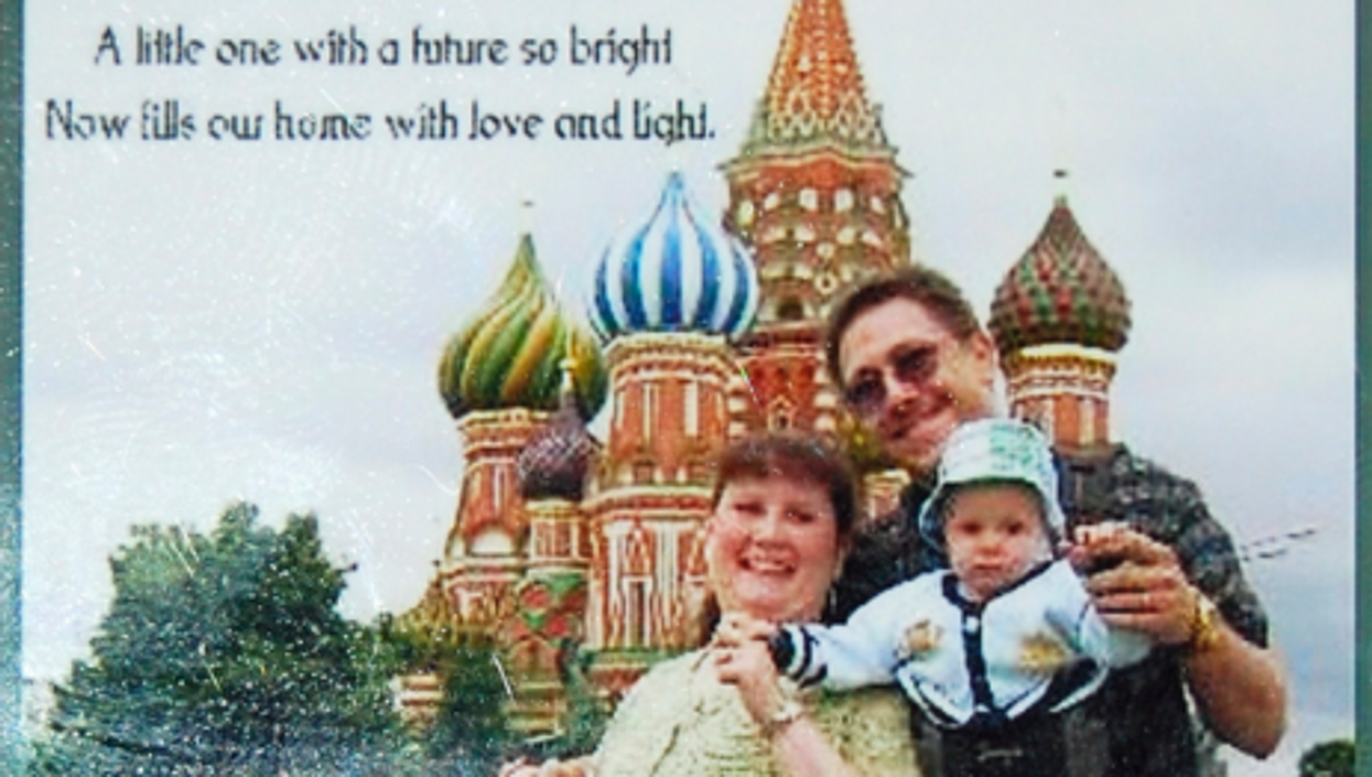An adoption announcement of a New Jersey couple and the baby boy adopted in Russia