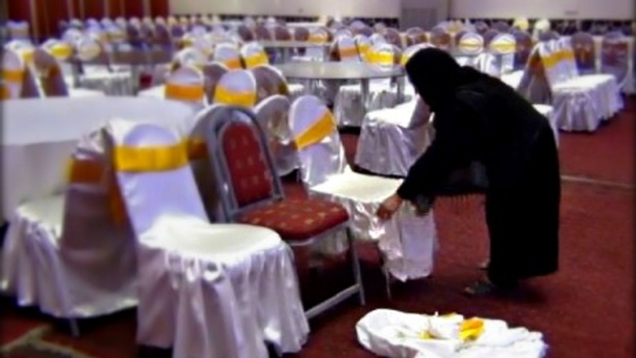 An Afghan woman works as a waitress at a wedding hall in Kabul.