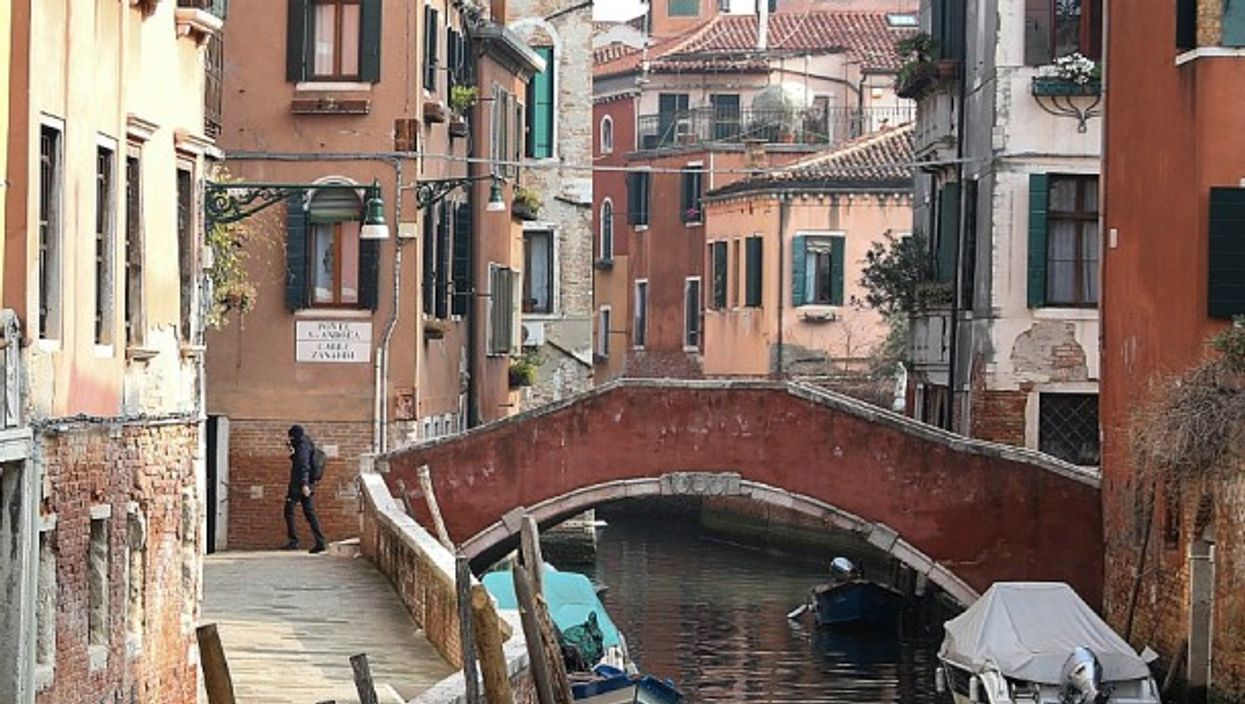 An almost empty canal street in Venice on Feb. 24