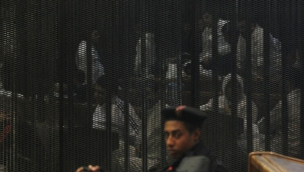 An Egyptian guard at a recent trial in Cairo.