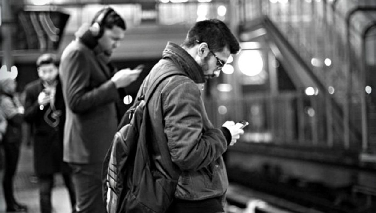 An idle moment waiting for the train resolved with phones