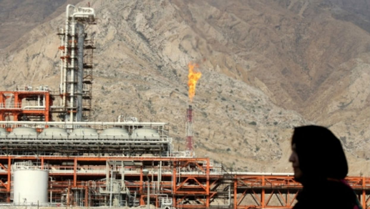 An Iranian woman walks at the South Pars gas field.