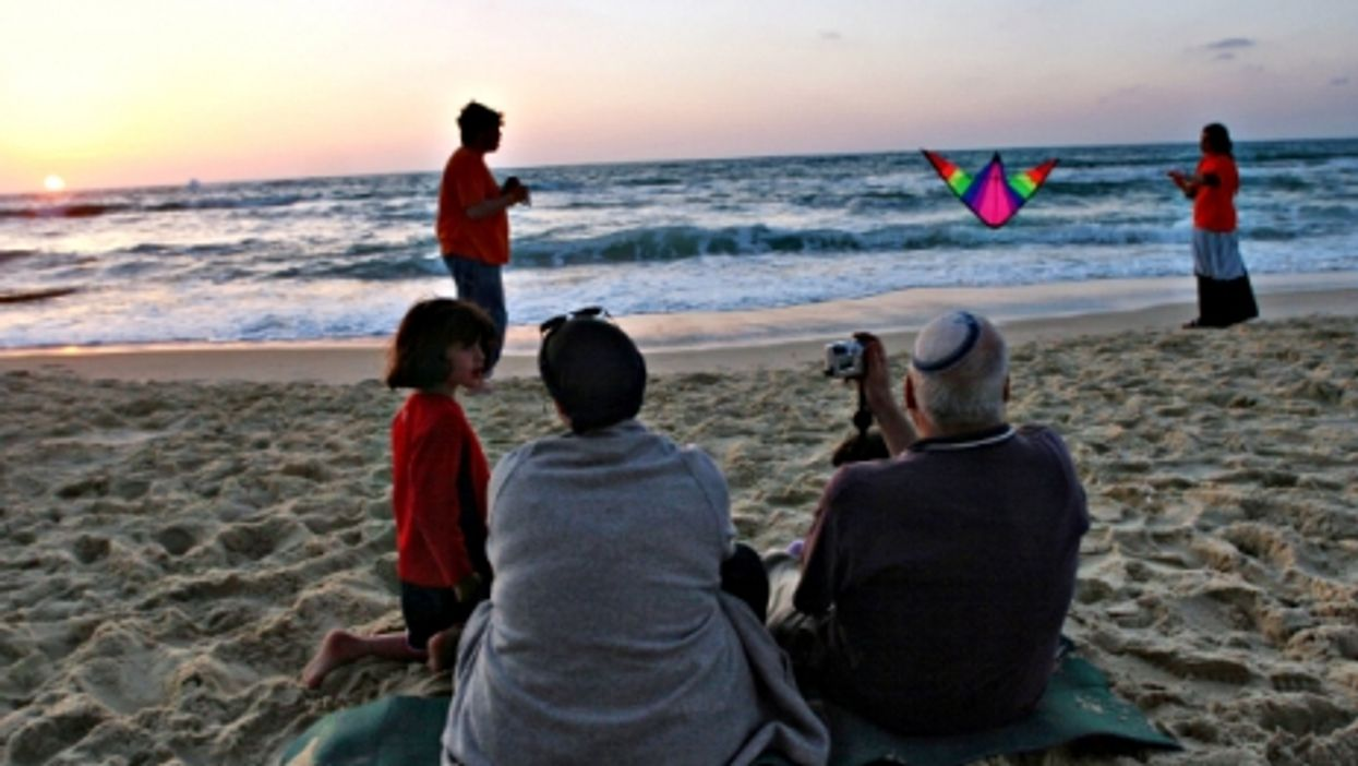 An Israeli family enjoying sunset on a beach