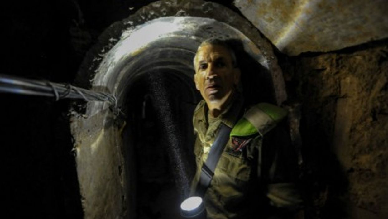 An Israeli officer shows the inside of a tunnel discovered last year near Kibbutz Ein Hashlosha