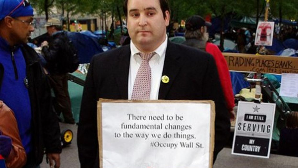 An Occupy Wall Street protester in banker's attire