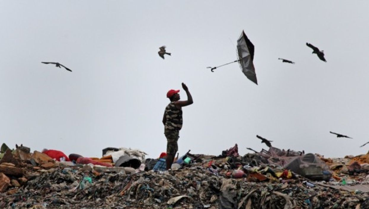 An umbrella flies out of a man's hand in Mumbai, India.