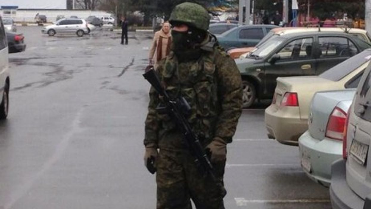 An unidentified soldier patroling a Crimean  airport