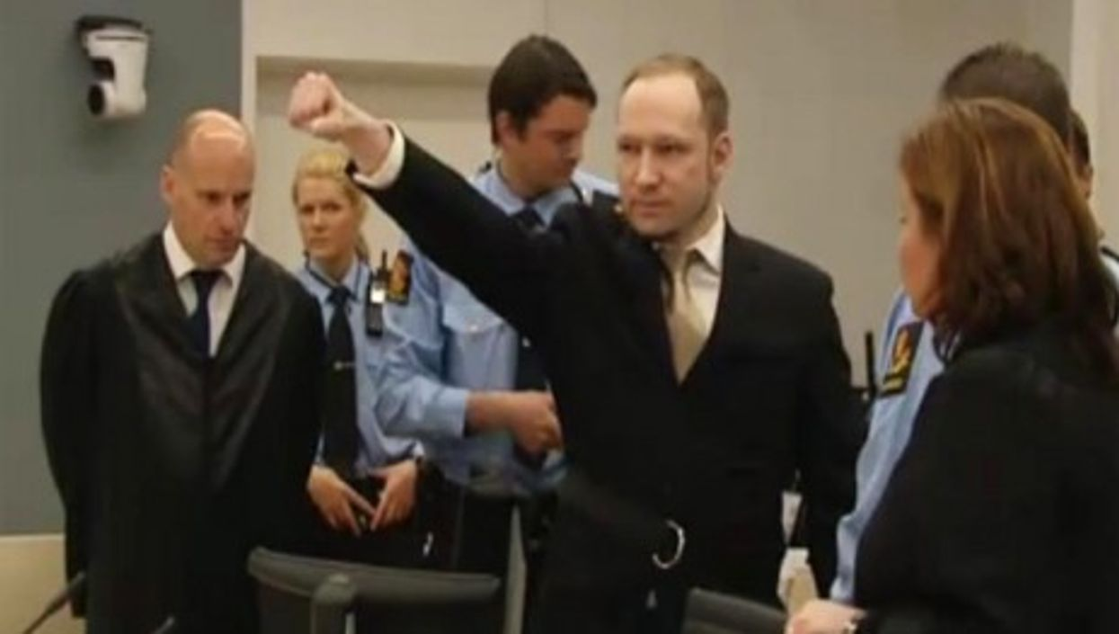Anders Breivik's closed-fist salute at the start of his trial in Oslo (BBC News)