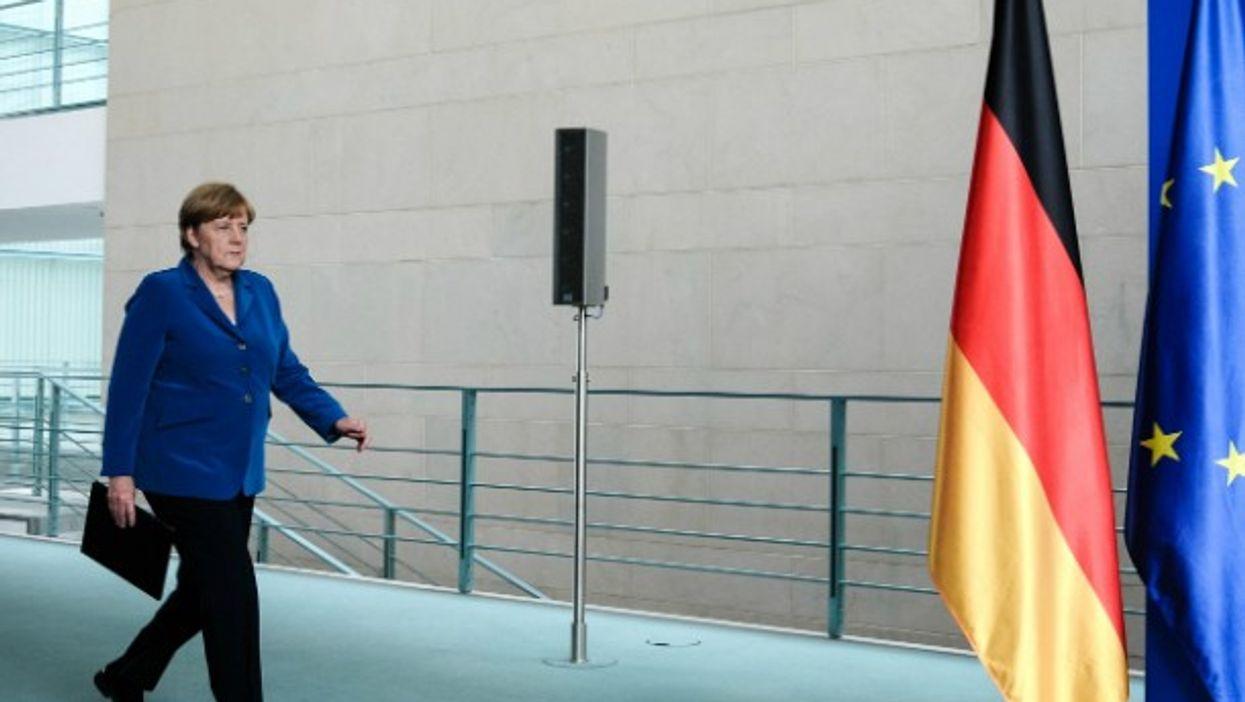 Angela Merkel attends press conference after shootout in Munich.