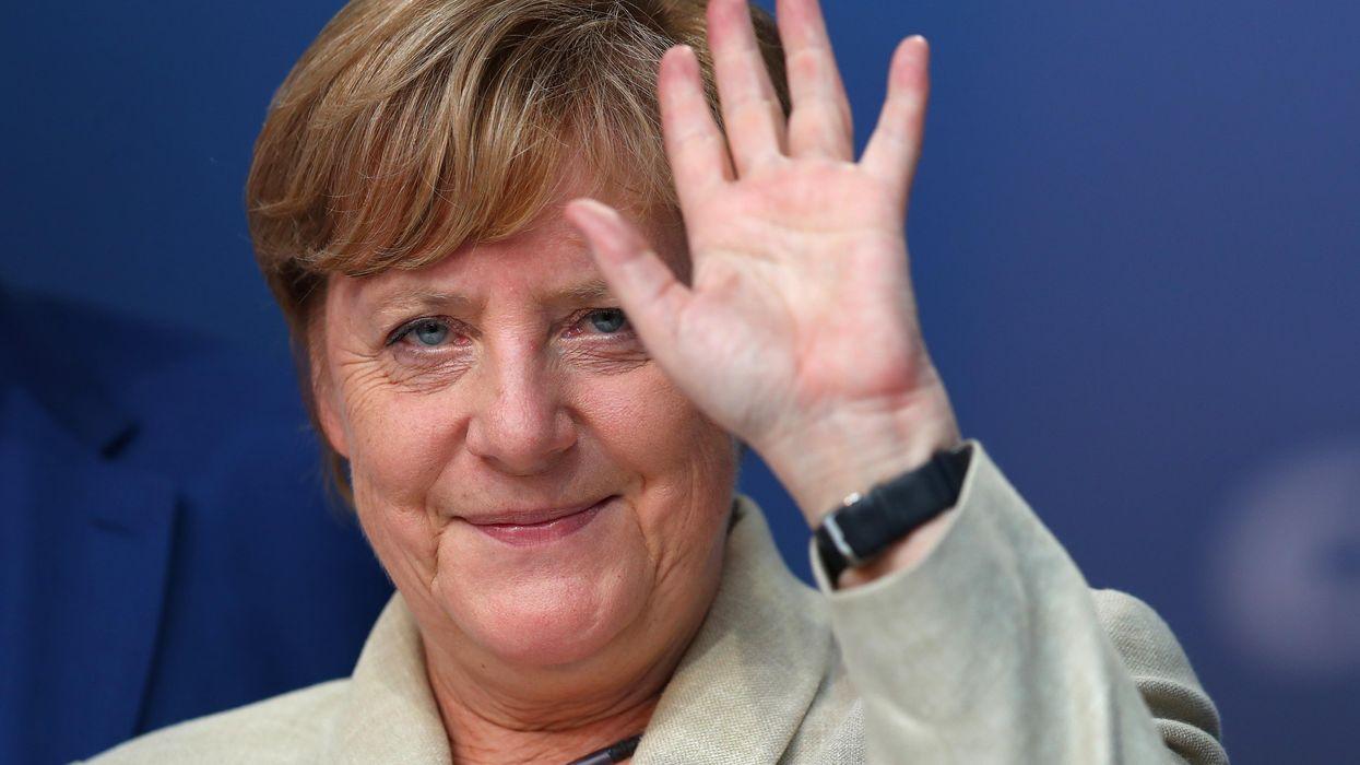 Angela Merkel waves to the crowd