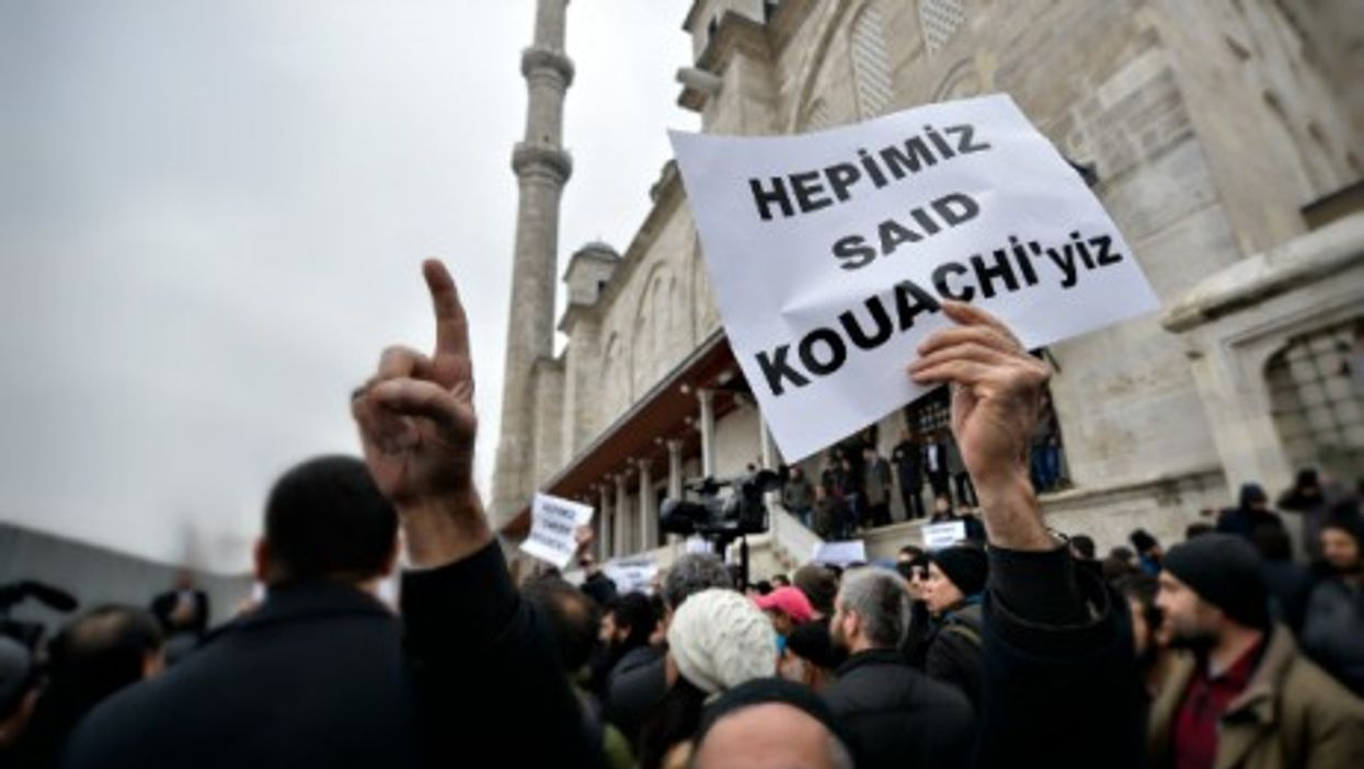"""Anti-Charlie Hebdo protester carrying a sign reading """"We are all Said Kouachi"""" in Instanbul on Jan. 16"""