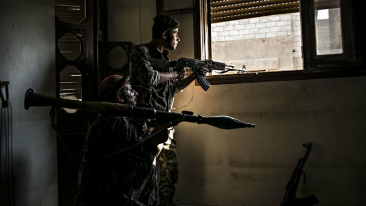 Anti-ISIS fighters in Raqqa in August.