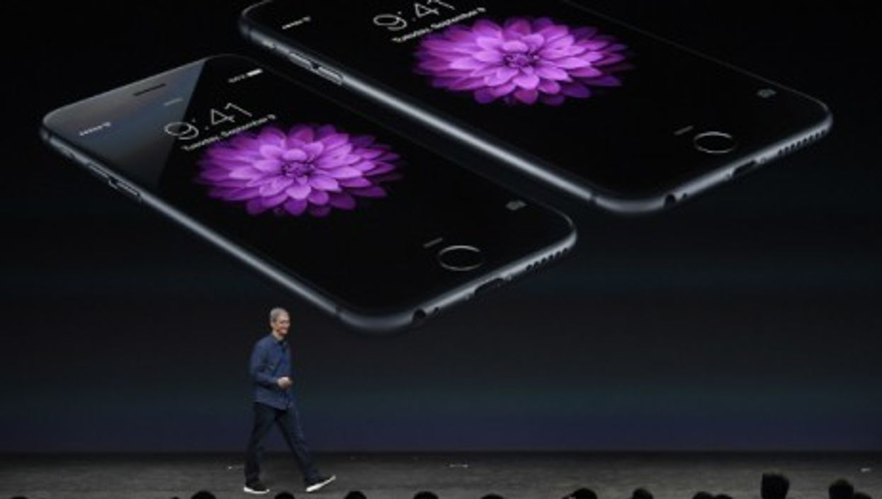 Apple CEO Tim Cook unveils the new iPhones 6 and 6 Plus