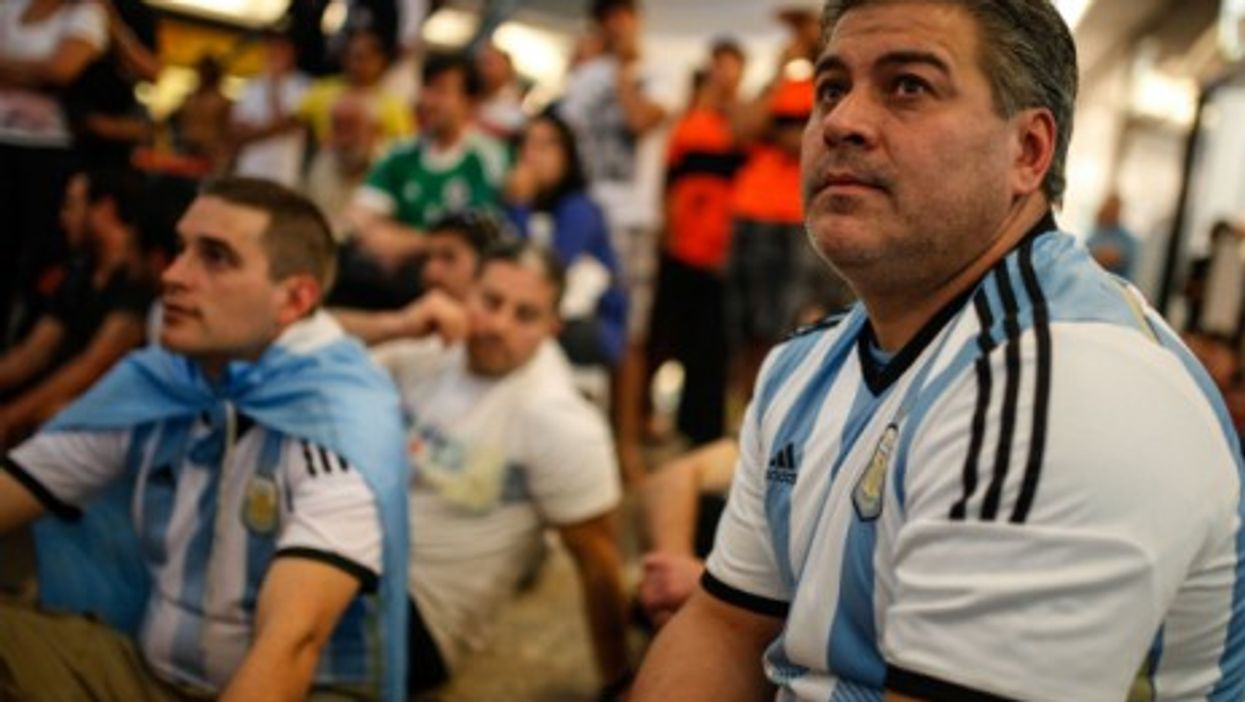 Argentina's fans react while watching the final match of the 2014 World Cup between Germany and Argentina in Brasilia, Brazil, on July 13, 2014.