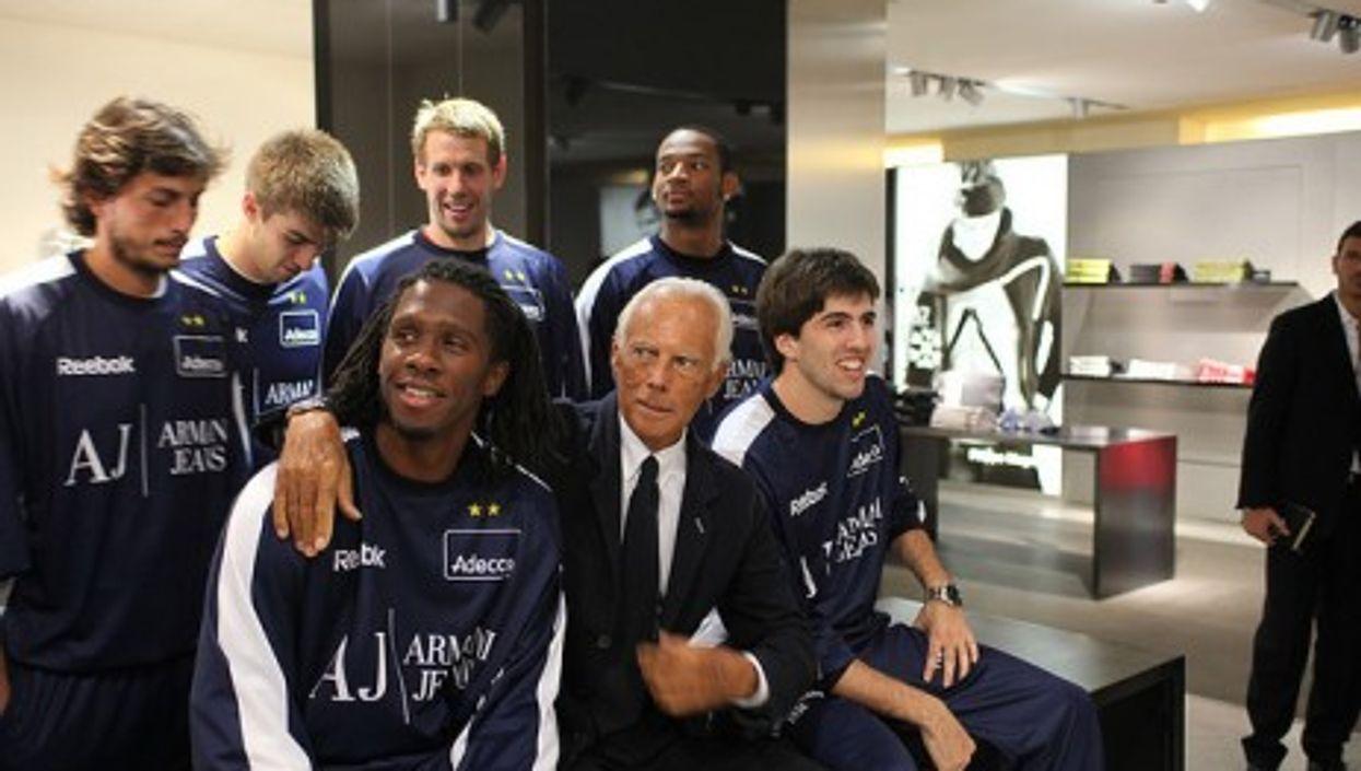Armani poses with Italian league Olimpia basketball players (br1dotcom)