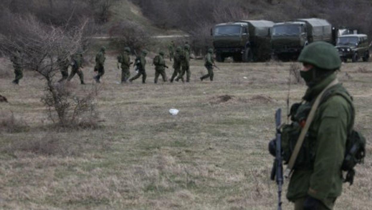 Armed guards outside a Ukrainian military compound in Simferopol, Crimea, on March 4