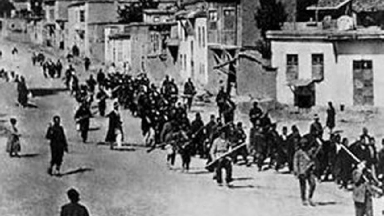 Armenian civilians are marched to a nearby prison in Mezireh by armed Ottoman soldiers (Wikipedia)