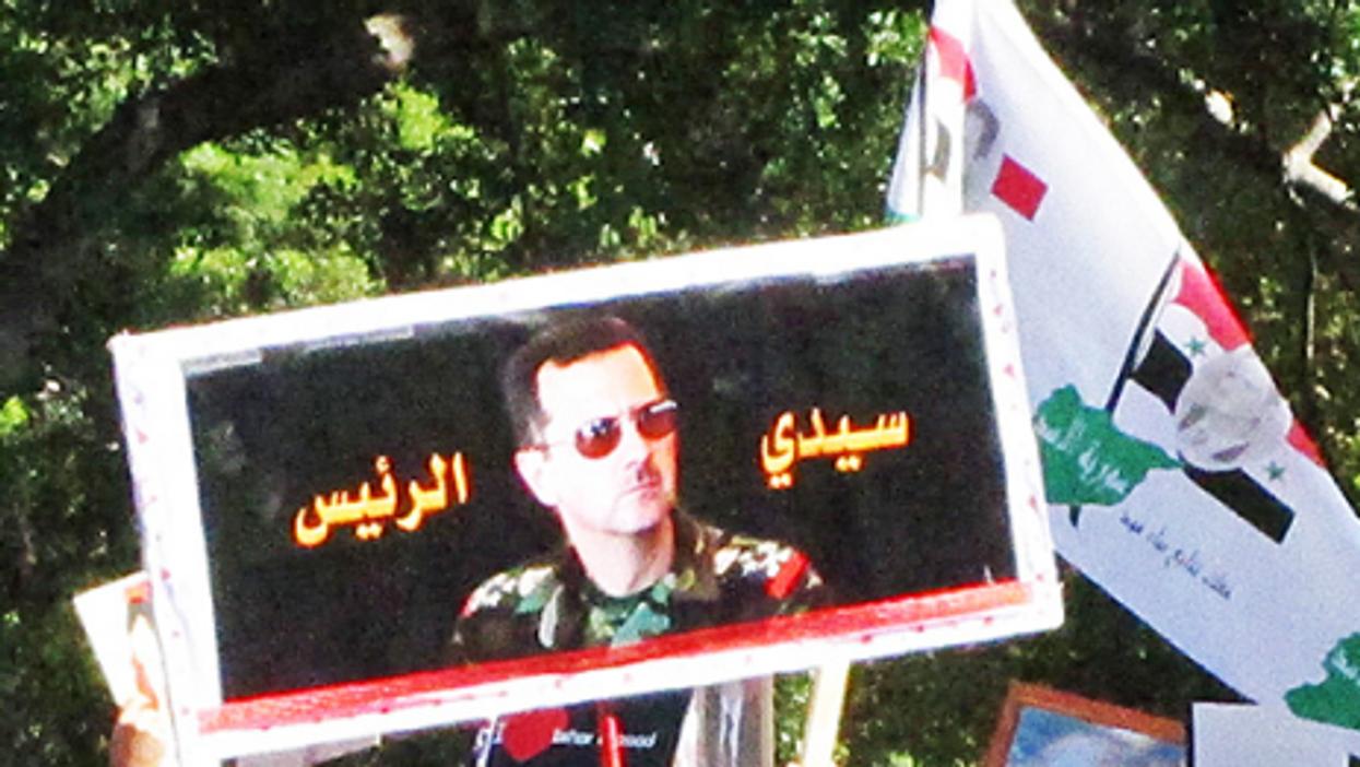 Assad (newtown grafitti)