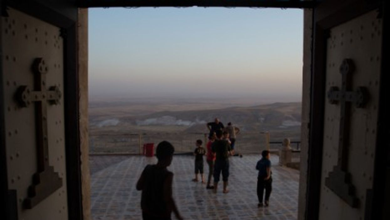 Assyrian Christian families who have fled ISIS and have taken refuge in the Mar Matta Monastery in northern Iraq.
