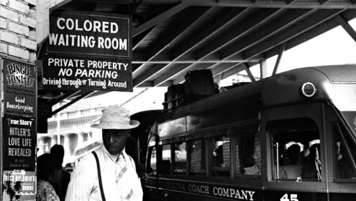 At a bus station in Durham, NC, in May 1940