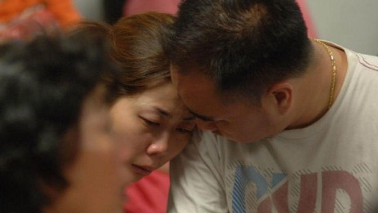 At Juanda Airport, relatives of the victims of the AirAsia plane crash
