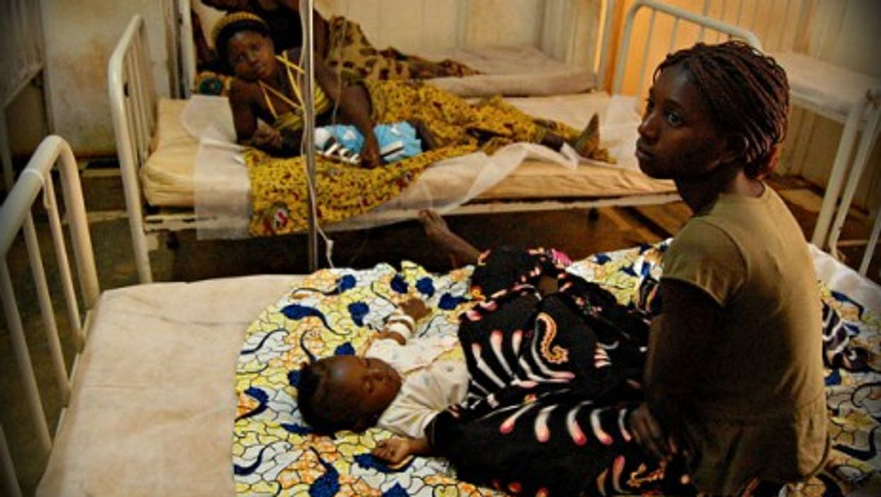 Baby receiving treatment for malaria at a municipal hospital in M'banza Congo