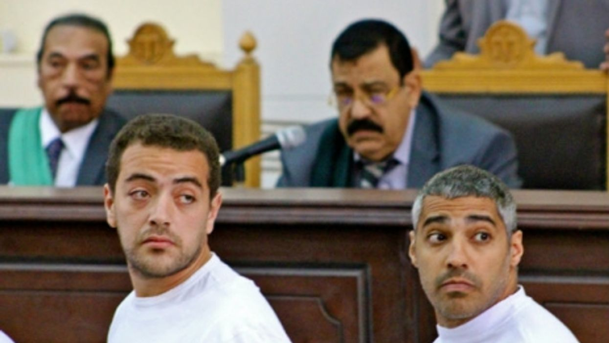 Baher Mohamed, left, and Mohamed Fadel Fahmy of al Jazeera English in court in Cairo last year