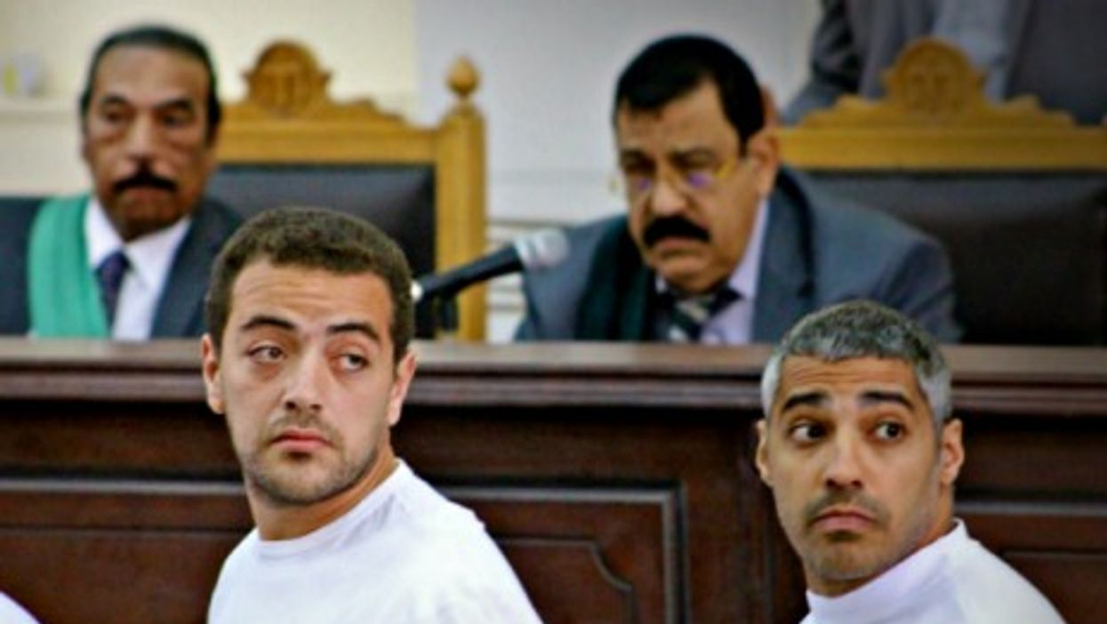 Baher Mohamed (left) and Mohamed Fahmy in a Cairo court in March 2014.