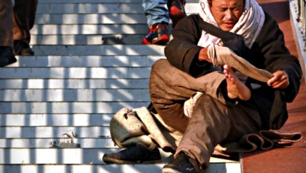 Beggar in Beijing, China