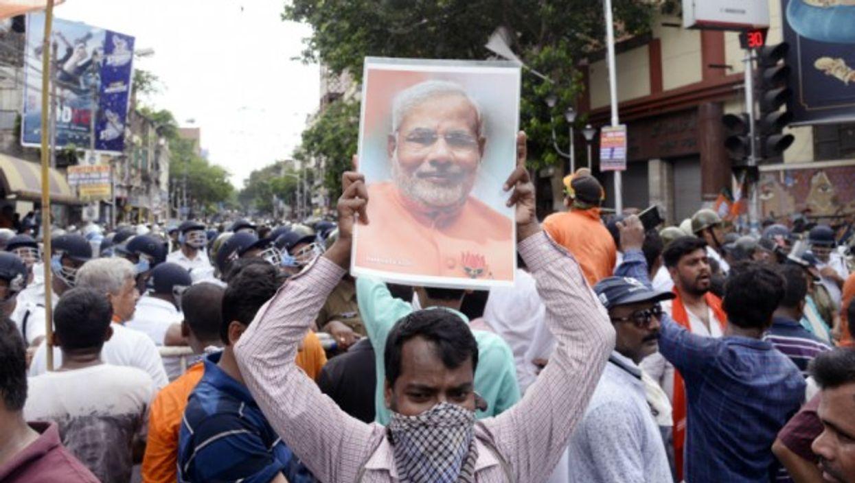 BJP activist hold Prime Minister Modi picture during BJP Lalabazar