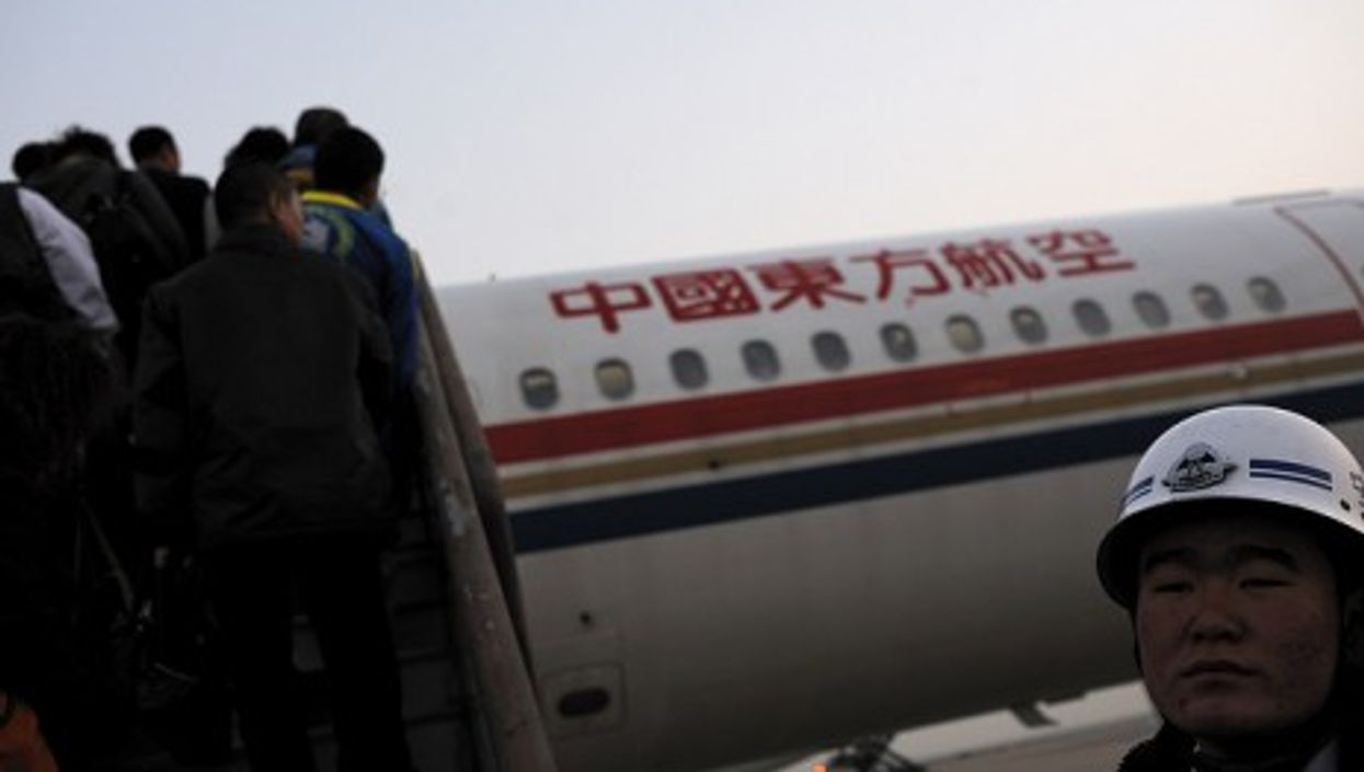 Boarding China Eastern Airlines at Shanghai airport where a Lucky Airlines pilot recently made news (Ed-meister)