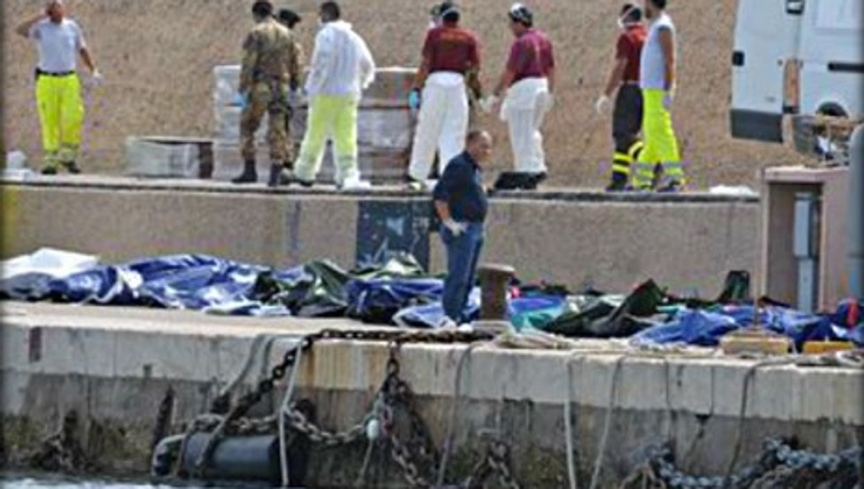 Bodies lined up on the dock in Lampedusa's main port