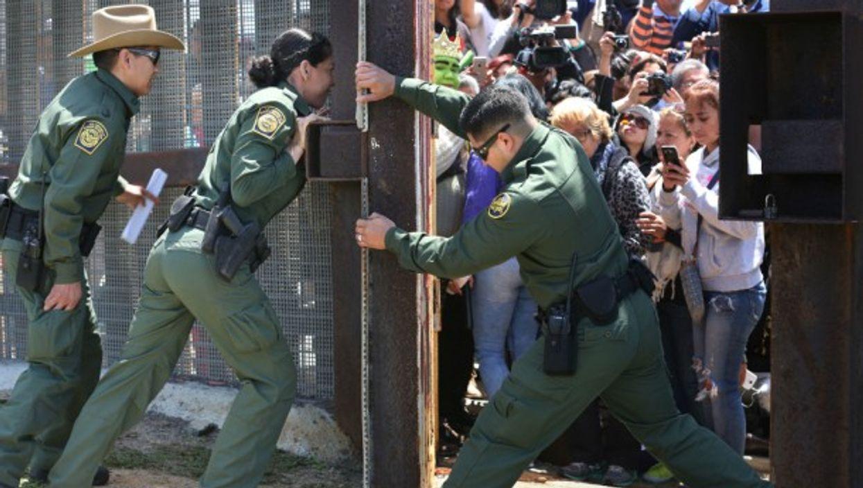 Border Patrol agents closing the Door of Hope between Tijuana and San Diego