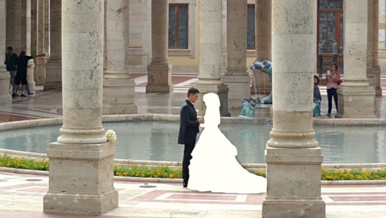 Bride and groom hold hands at their wedding in Italy