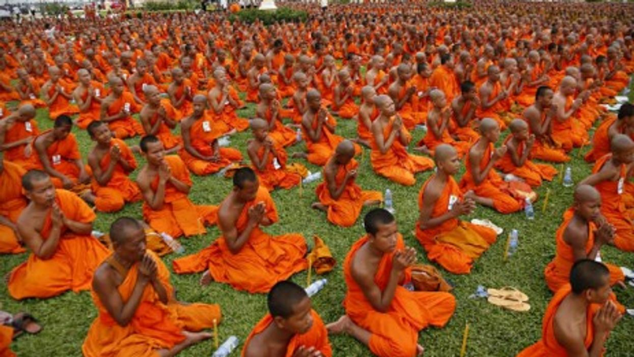Buddhist monks chant prayers Thursday in Phnom Penh for the enshrinement of late King-Father Norodom Sihanouk.