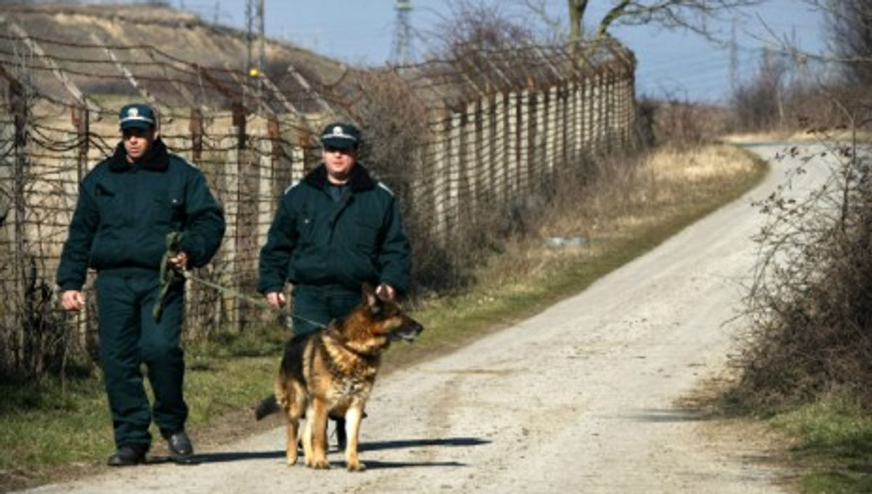 Bulgarian customs officers near the border fence between Bulgaria and Turkey