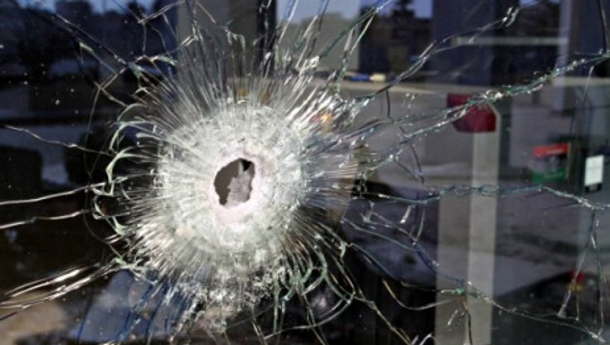Bullet hole left by the Jan. 27 attack on Tripoli's Corinthia Hotel