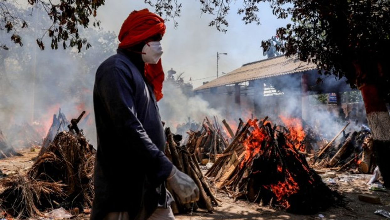 Burning pyres at a crematorium in New Delhi