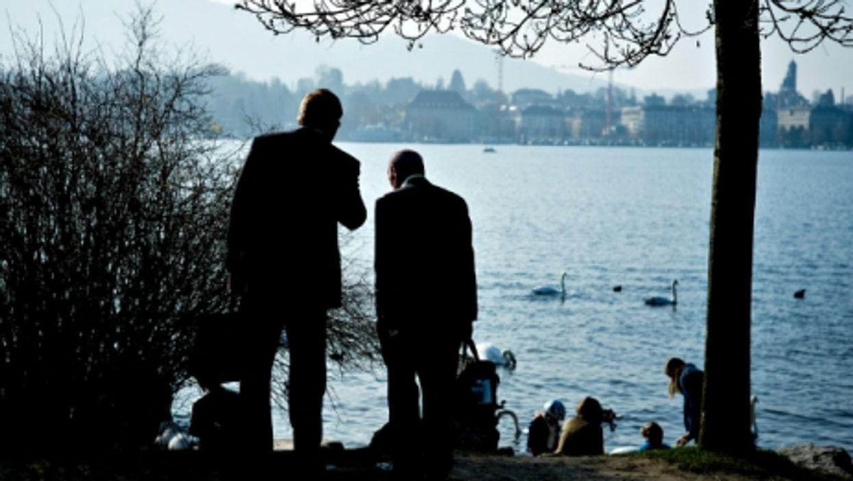 Businessmen by Lake Zurich