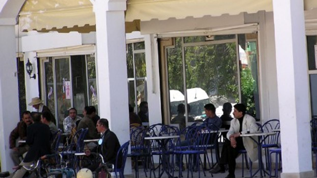 Cafe goers relaxing on the Tunisian ilsand of Djerba