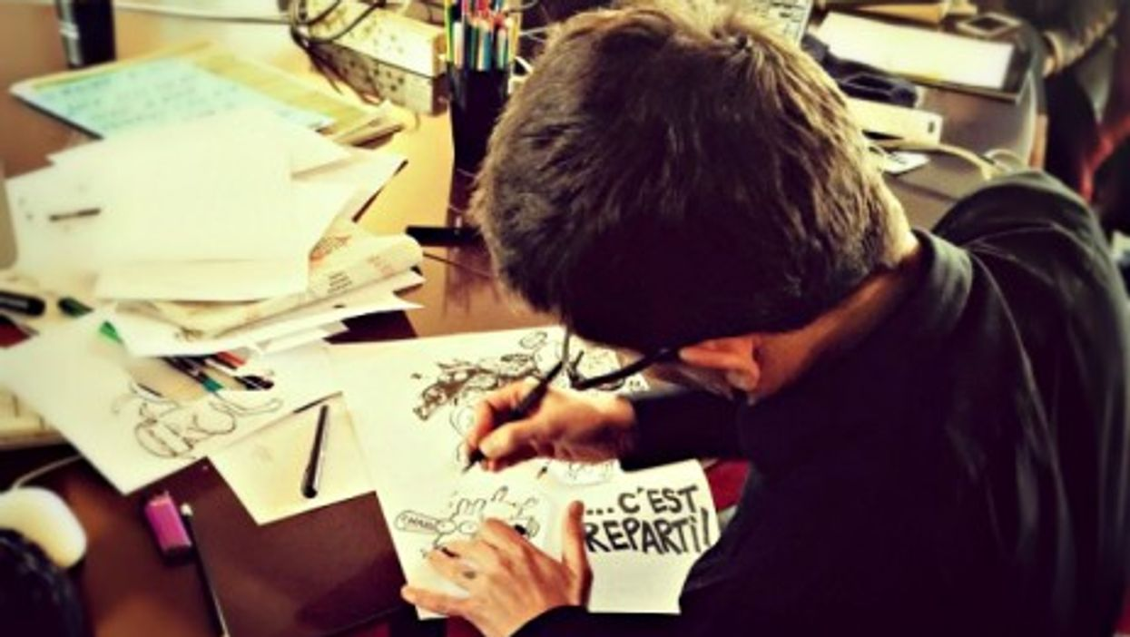 Cartoonist Luz drawing the cover of Charlie's Hebdo Feb. 25 edition
