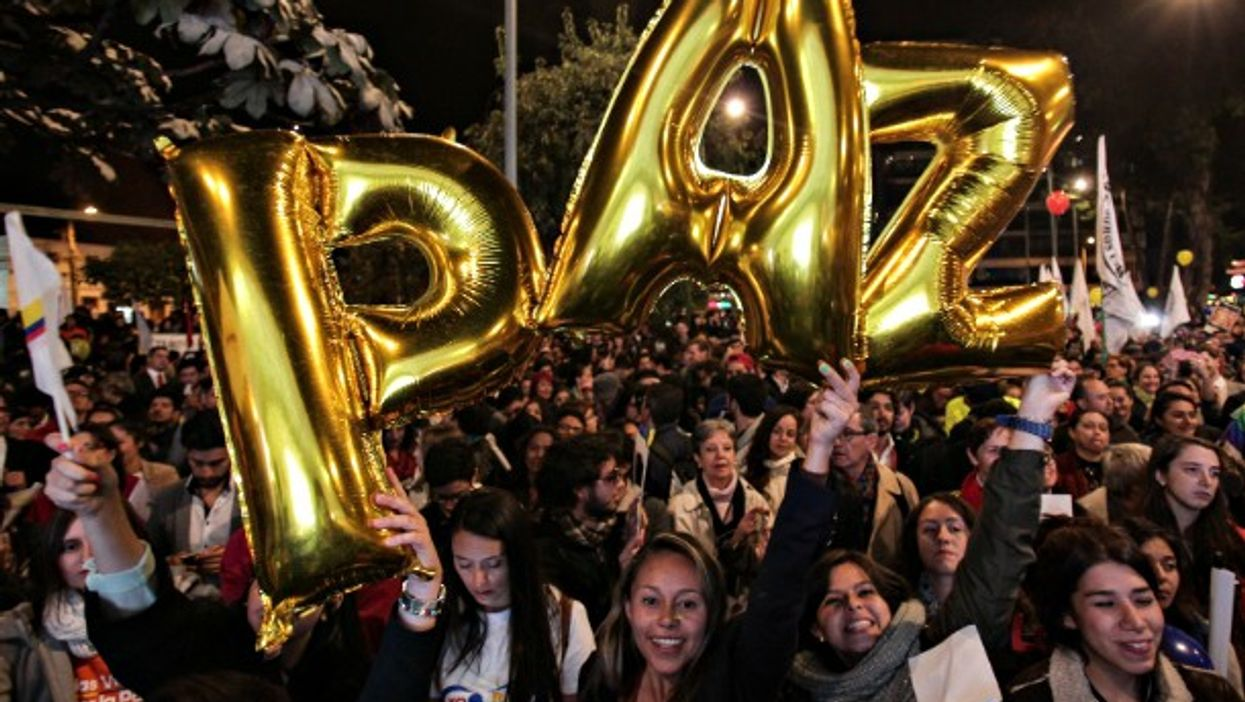 Celebrating the peace deal with balloons in Bogota on Aug. 24