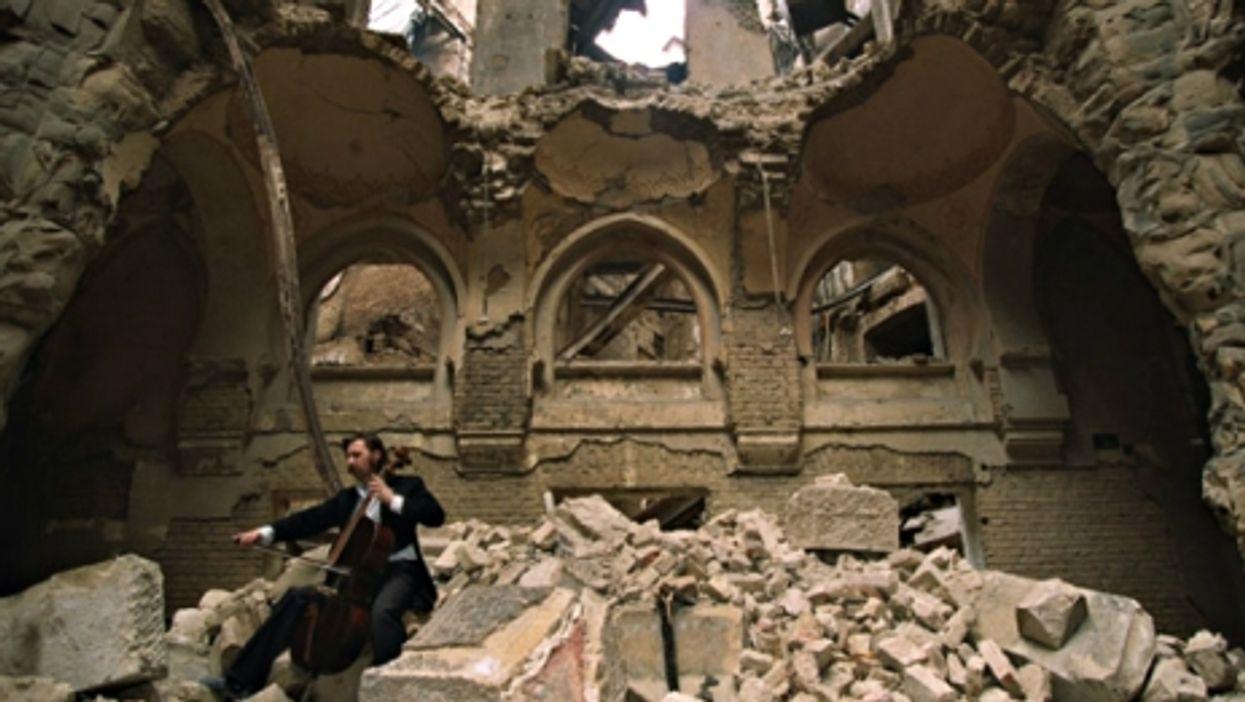 Cellist Vedran Smajlovic in 1992 in Sarajevo's destroyed National Library